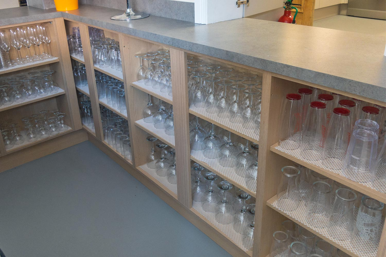 Bar area with glasses on shelves